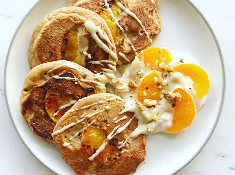 fluffy clementine pancakes with tahini yoghurt and fresh orange slices