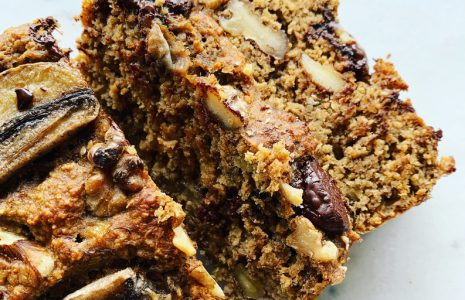 slices of chocolate studded banana bread topped with banana and walnuts