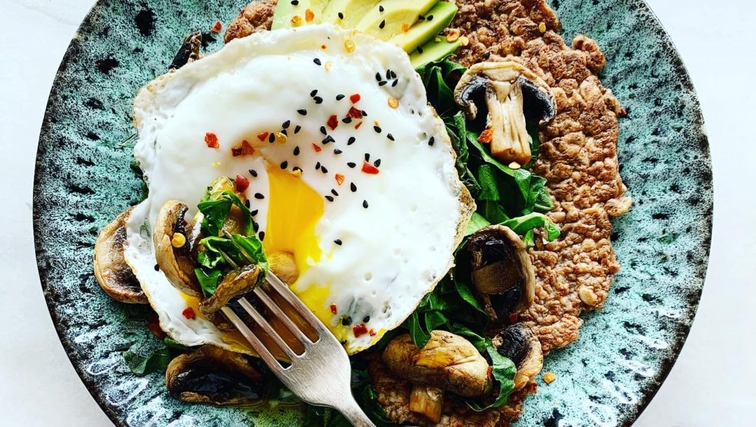 crispy gluten free oat crepes topped with avocado, greens, mushrooms & a runny fried egg